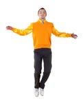 Hombre feliz joven en desgaste brillante del color imágenes de archivo libres de regalías