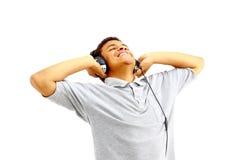 Hombre feliz joven que escucha Imágenes de archivo libres de regalías