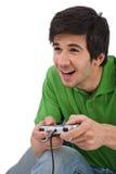 Hombre feliz joven que juega al juego video Imagenes de archivo