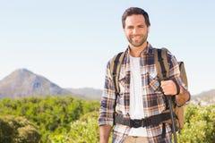 Hombre feliz que camina en las montañas Imágenes de archivo libres de regalías