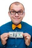 Hombre feliz que lleva a cabo cientos dólares Fotografía de archivo libre de regalías