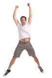 Hombre feliz que salta en un fondo blanco Imágenes de archivo libres de regalías