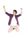 Hombre feliz que se arrodilla en piso Fotografía de archivo libre de regalías