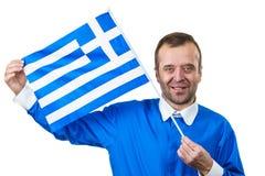 Hombre feliz que sostiene la bandera griega fotos de archivo