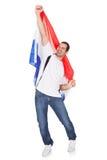 Hombre feliz que sostiene una bandera holandesa Fotografía de archivo