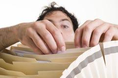 Hombre fileing Fotos de archivo libres de regalías