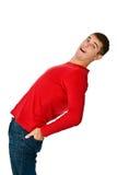 Hombre flexible en ropa y pantalones vaqueros rojos Fotografía de archivo libre de regalías