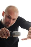 Hombre fresco con el nuevo teléfono móvil Fotografía de archivo libre de regalías