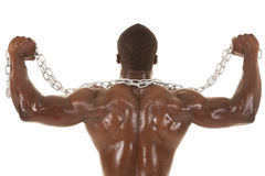Hombre fuerte con la flexión de la parte posterior de la cadena Imagenes de archivo