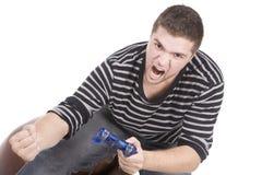 Hombre furioso con la palanca de mando en la mano Imagenes de archivo