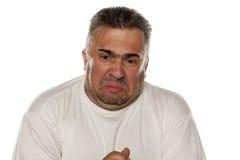 Hombre gordo asqueado Fotografía de archivo