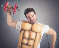 Hombre gordo con ABS Foto de archivo libre de regalías