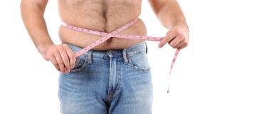 Hombre gordo con cinta métrica alrededor de la cintura Imagen de archivo libre de regalías