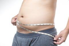 Hombre gordo con cinta métrica alrededor de la cintura Imagenes de archivo