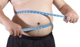Hombre gordo con la cinta de la medida Imagen de archivo libre de regalías