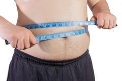Hombre gordo con la cinta de la medida Foto de archivo