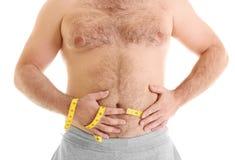 Hombre gordo con la cinta métrica Fotografía de archivo