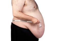 Hombre gordo con una cinta métrica Imágenes de archivo libres de regalías