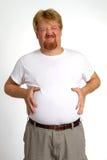 Hombre gordo de la indigestión Foto de archivo