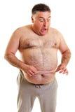 Hombre gordo expresivo con una cinta métrica Foto de archivo