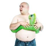 Hombre gordo que busca la piscina Imagen de archivo