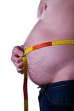 Hombre gordo que sostiene una cinta de la medida Fotografía de archivo libre de regalías