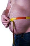 Hombre gordo que sostiene una cinta de la medida Imagen de archivo