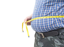 Hombre gordo que sostiene una cinta de la medida aislada Imagen de archivo