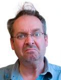 Hombre gruñón con el pelo desalinado Fotografía de archivo