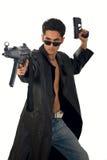 Hombre hermoso con el arma en el impermeable de cuero Imágenes de archivo libres de regalías