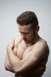 Hombre hermoso con el dolor del cuerpo Foto de archivo libre de regalías