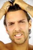 Hombre hermoso con el primer del dolor de cabeza Fotos de archivo