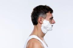 Hombre hermoso con espuma en cara Fotos de archivo libres de regalías