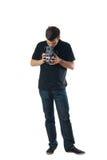 Hombre hermoso con la cámara de la foto de la vendimia confundida Imágenes de archivo libres de regalías
