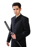Hombre hermoso con la espada. Foto de archivo libre de regalías