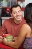 Hombre hermoso con la señora en café Imagen de archivo libre de regalías