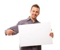 Hombre hermoso con la tarjeta Foto de archivo libre de regalías