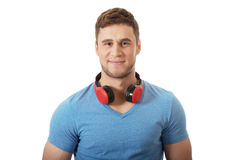 Hombre hermoso con los auriculares Fotografía de archivo libre de regalías
