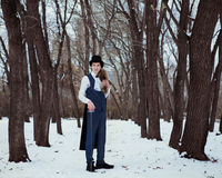Hombre hermoso del elegantyoung con el estoque, al aire libre Foto de archivo