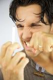 Hombre hermoso enojado con el cigarrillo Imagenes de archivo