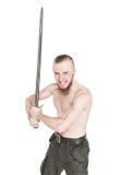Hombre hermoso joven con el griterío de la espada aislado Foto de archivo libre de regalías