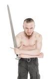 Hombre hermoso joven con la espada aislada Foto de archivo libre de regalías