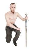 Hombre hermoso joven con la espada aislada Imágenes de archivo libres de regalías