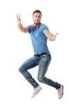 Hombre hermoso que salta para la alegría Fotos de archivo
