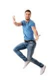 Hombre hermoso que salta para la alegría Foto de archivo libre de regalías
