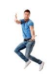 Hombre hermoso que salta para la alegría Fotografía de archivo