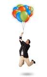 Hombre hermoso que sostiene los globos coloridos Imagen de archivo libre de regalías