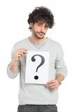 Hombre incierto que muestra la pregunta Mark Sign Imágenes de archivo libres de regalías