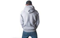 Hombre, individuo en la sudadera con capucha gris en blanco, camiseta, mofa para arriba aislada Pla Fotografía de archivo libre de regalías