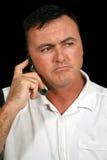 Hombre infeliz del teléfono celular imagenes de archivo
